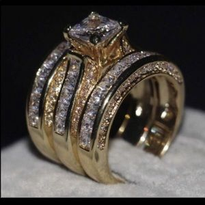 New 14 k yellow gold wedding ring. Set